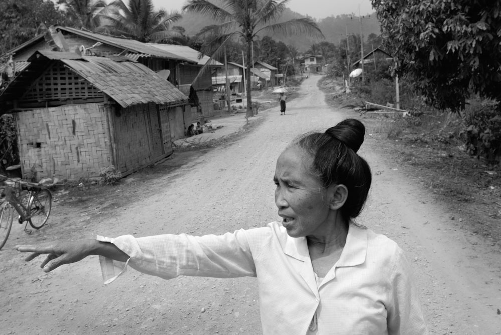 Noi points to where her family house used to be in Sophoon before it was destroyed in a US bombing raid in 1964.